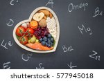 healthy food in heart and... | Shutterstock . vector #577945018