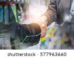 business handshake closing a... | Shutterstock . vector #577963660