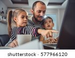 father with two children... | Shutterstock . vector #577966120