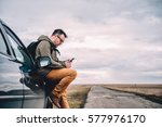 man sitting on the car and...   Shutterstock . vector #577976170