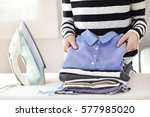 ironing clothes on ironing board | Shutterstock . vector #577985020