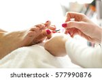 beautician doing pedicure. | Shutterstock . vector #577990876