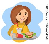 woman with a tray of food in... | Shutterstock .eps vector #577996588