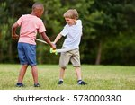 two children fighting as... | Shutterstock . vector #578000380
