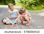 two girls painting hopscotch... | Shutterstock . vector #578000410