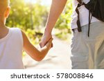 child holding hand of adult... | Shutterstock . vector #578008846
