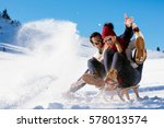 young couple sledding and... | Shutterstock . vector #578013574