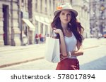fashionably dressed woman on... | Shutterstock . vector #578017894