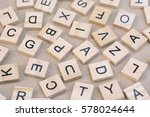 Small photo of background of letterpress wood type printing blocks, random letters of alphabet and punctuation stained by black inks