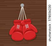 red hanging boxing gloves... | Shutterstock .eps vector #578036230