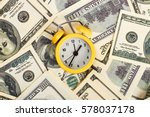 Alarm Clock And Dollars. Time...