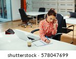 secretary on phone writing a... | Shutterstock . vector #578047699