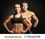 sporty young couple on black... | Shutterstock . vector #578060098