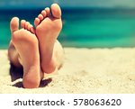 tanned well groomed feet amid... | Shutterstock . vector #578063620