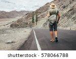 alone traveler walks on the... | Shutterstock . vector #578066788
