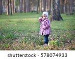 little girl walks in the spring ... | Shutterstock . vector #578074933