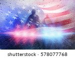 Small photo of Police crime scene, rain background with police lights and american flag
