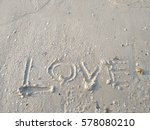 Writing Love On Sand