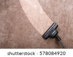vacuuming carpet with vacuum... | Shutterstock . vector #578084920