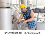 young manual worker using... | Shutterstock . vector #578086126