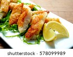 fried fish dish on white plate... | Shutterstock . vector #578099989