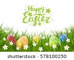 color easter eggs on green grass | Shutterstock .eps vector #578100250