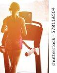 girl runs on treadmill. active... | Shutterstock . vector #578116504
