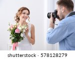 wedding photographer taking... | Shutterstock . vector #578128279