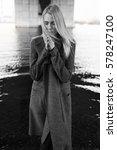 beautiful blonde in a gray coat ... | Shutterstock . vector #578247100