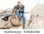 beautiful young couple sitting... | Shutterstock . vector #578281408
