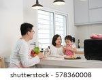 asian family enjoying and... | Shutterstock . vector #578360008