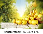 yellow lemons on wooden table... | Shutterstock . vector #578375176