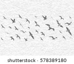 flying birds silhouettes on... | Shutterstock . vector #578389180