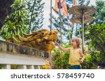 boy tourist in buddhist temple... | Shutterstock . vector #578459740