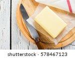 butter stick on wooden board.... | Shutterstock . vector #578467123