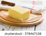 butter stick on wooden board.... | Shutterstock . vector #578467138