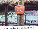 free wifi arrow on the beach.... | Shutterstock . vector #578472010