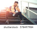 portrait of young man drinking... | Shutterstock . vector #578497984