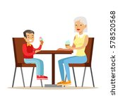 grandmother and a boy eating... | Shutterstock .eps vector #578520568