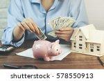 woman hand money and piggy bank ... | Shutterstock . vector #578550913