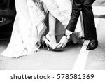 The Groom Helps The Bride To...