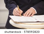 the groom signs the marriage... | Shutterstock . vector #578592820