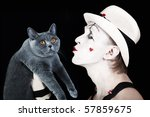 Mime In A White Hat Holding A...