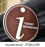 Brown tourist information sign mounted on the facade of a building - stock photo