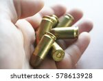 bullets in hand close up high... | Shutterstock . vector #578613928