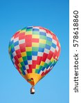 Small photo of Hot air balloon, colorful checkered aerostat on blue sky