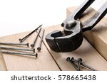 black pincers and nails on a... | Shutterstock . vector #578665438