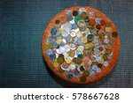 Small photo of lots of coins lying in a circle/money makes the world go around/accumulation of capital,-different currencies