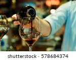 red wine pouring into a wine... | Shutterstock . vector #578684374