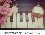 Small photo of Piano keyboard, pocket watch and flower wallpaper background, valentines concept, process vintage tone